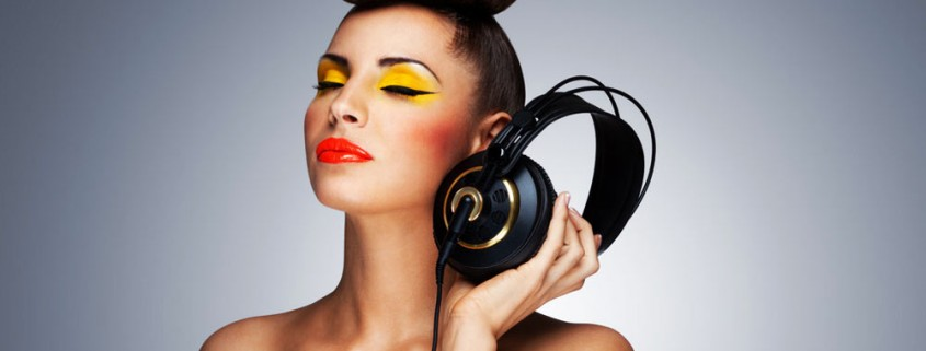 beautiful girl holding headphones