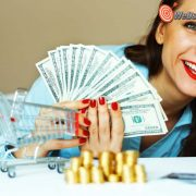 Young smiling woman holding cash